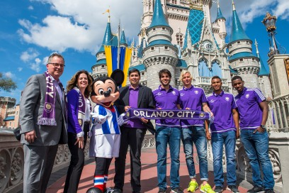 LAKE BUENA VISTA, Fla. (March 3, 2015) – Walt Disney World President George Kalogridis, Senior Vice President of Disney Sports Enterprises Maribeth Bisienere, Mickey Mouse, Orlando City Soccer Club owner Flávio Augusto da Silva and several players, including Kaká, pose in front of Cinderella Castle at the Magic Kingdom to mark the announcement of a multi-year agreement between the two brands. The deal, announced March 4, makes Walt Disney World Resort a founding sponsor of the club mere days before Orlando City will make their Major League Soccer debut March 8 on ESPN2.